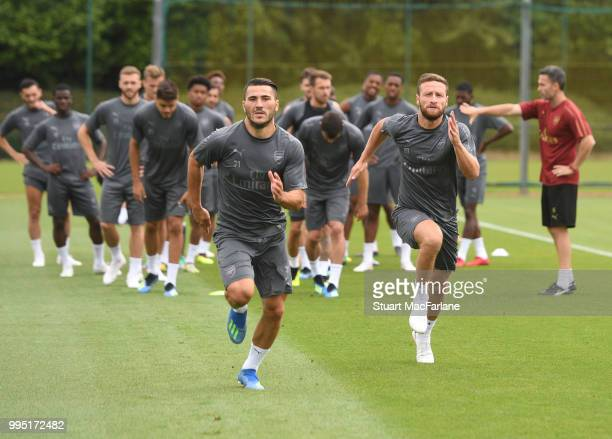 Sead Kolasinac and Shkodran Mustafi of Arsenal during a training session at London Colney on July 10 2018 in St Albans England