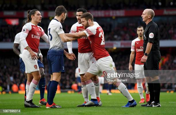 Sead Kolasinac and Shkodran Mustafi of Arsenal react to Ben Davies of Tottenham Hotspur during the Premier League match between Arsenal FC and...