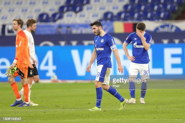 Sead Kolasinac and Shkodran Mustafi of FC Schalke 04 look dejected after the Bundesliga match between FC Schalke 04 and Borussia Moenchengladbach at...