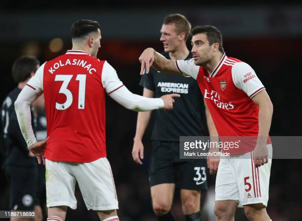 Sead Kolasinac and Sokratis of Arsenal have a discussion about defending during the Premier League match between Arsenal FC and Brighton Hove Albion...