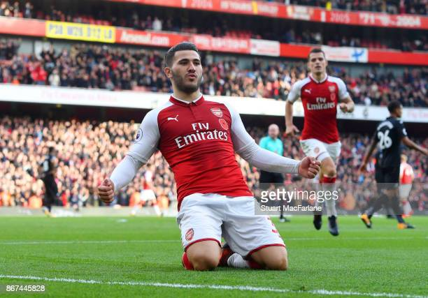 Sead Kolasinac celebrates scoring the 1st Arsenal goal during the Premier League match between Arsenal and Swansea City at Emirates Stadium on...