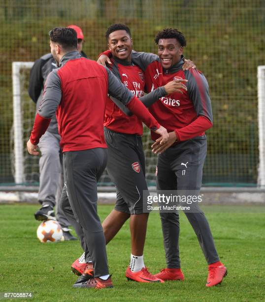 Sead Kolasinac Chuba Akpom and Alex Iwobi of Arsenal during a training session at London Colney on November 21 2017 in St Albans England