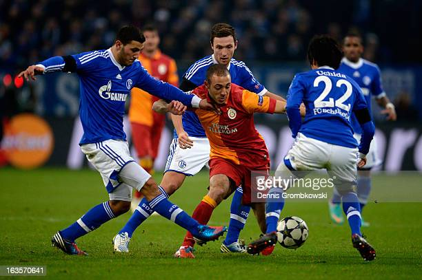 Sead Kolasinac Marco Hoeger and Atsuto Uchida of Schalke challenge Nordin Amrabat of Galatasaray during the UEFA Champions League round of 16 second...