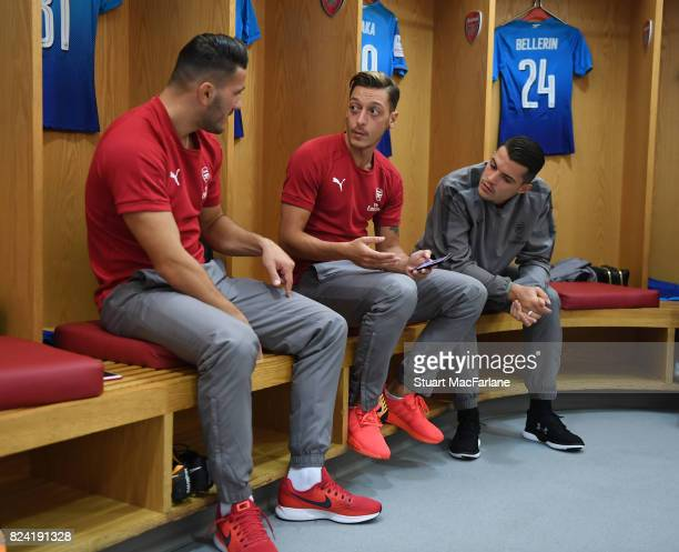 Sead Kolasinac Mesut Ozil and Granit Xhaka in the Arsenal changing room before the Emirates Cup match between Arsenal and SL Benfica at Emirates...