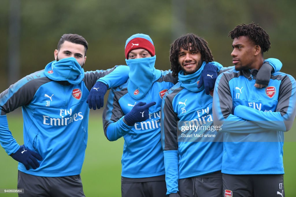 Sead Kolasinac, Mesut Ozil, Mo Elneny and alex Iwobi of Arsenal during a training session at London Colney on March 31, 2018 in St Albans, England.