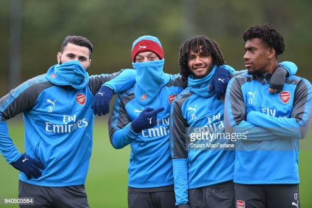 Sead Kolasinac Mesut Ozil Mo Elneny and alex Iwobi of Arsenal during a training session at London Colney on March 31 2018 in St Albans England