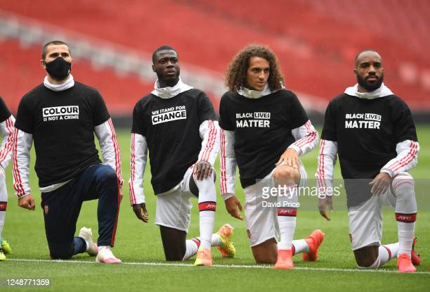 Sead Kolasinac Nicolas Pepe Matteo Guendouzi and Alexandre Lacazette of Arsenal take a knee in support of Black Lives Matter before the friendly...