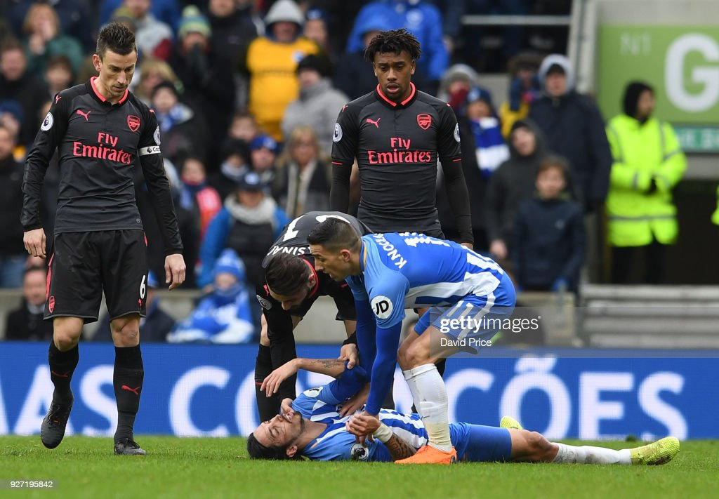Sead Kolasinac of Arsenal and check Anthony Knockhaert of Brighton on Ezequiel Schelotto of Brighton during the Premier League match between Brighton and Hove Albion and Arsenal at Amex Stadium on March 4, 2018 in Brighton, England.