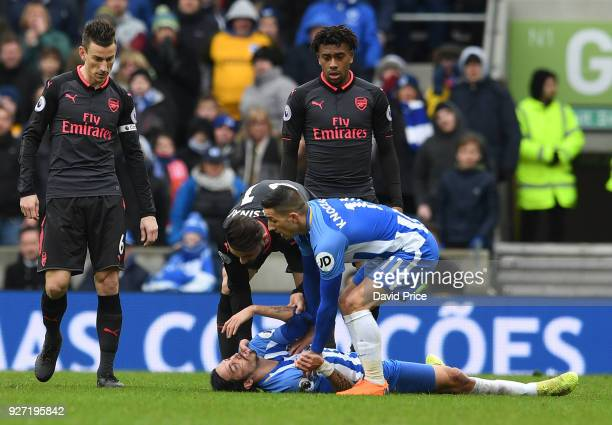 Sead Kolasinac of Arsenal and check Anthony Knockhaert of Brighton on Ezequiel Schelotto of Brighton during the Premier League match between Brighton...