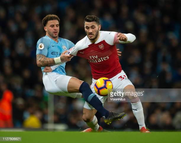 Sead Kolasinac of Arsenal and Kyle Walker of Manchester City in action during the Premier League match between Manchester City and Arsenal FC at...