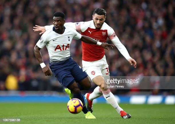 Sead Kolasinac of Arsenal battles for possession with Serge Aurier of Tottenham Hotspur during the Premier League match between Arsenal FC and...