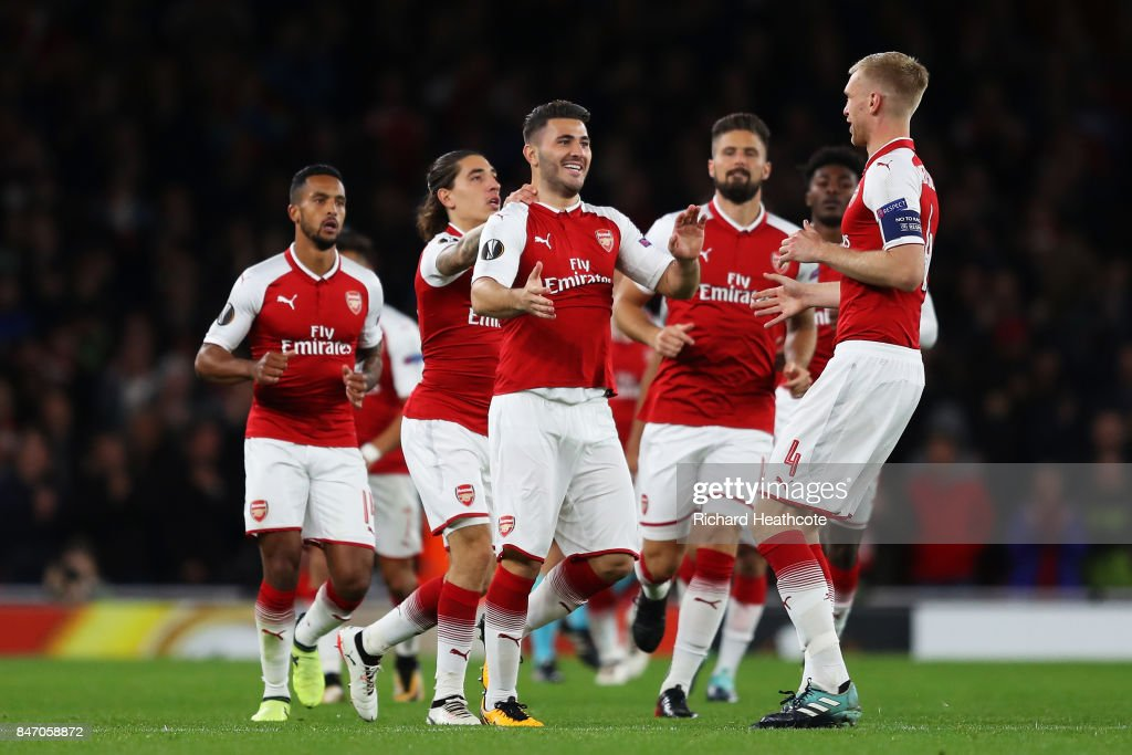 Sead Kolasinac of Arsenal celebrates scoring the first Arsenal goal with team mates during the UEFA Europa League group H match between Arsenal FC and 1. FC Koeln at Emirates Stadium on September 14, 2017 in London, United Kingdom.