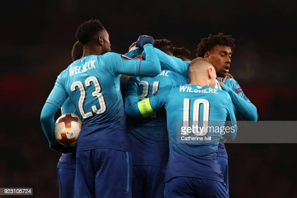 Sead Kolasinac of Arsenal celebrates scoring the first Arsenal goal with team mates during UEFA Europa League Round of 32 match between Arsenal and...