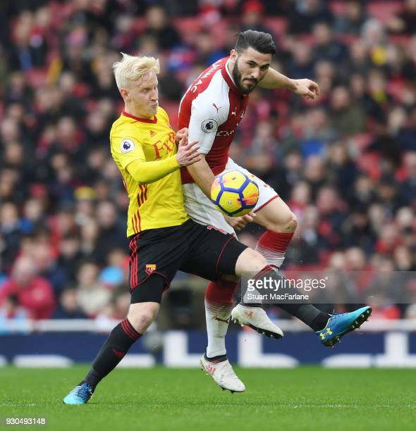 Sead Kolasinac of Arsenal challenges Will Hughes of Watford during the Premier League match between Arsenal and Watford at Emirates Stadium on March...