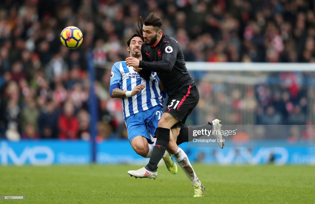 Sead Kolasinac of Arsenal clashes with Matias Ezequiel Schelotto of Brighton and Hove Albion during the Premier League match between Brighton and Hove Albion and Arsenal at Amex Stadium on March 4, 2018 in Brighton, England.