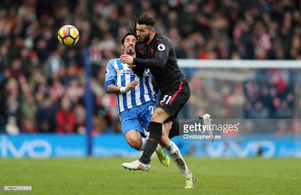 Sead Kolasinac of Arsenal clashes with Matias Ezequiel Schelotto of Brighton and Hove Albion during the Premier League match between Brighton and...