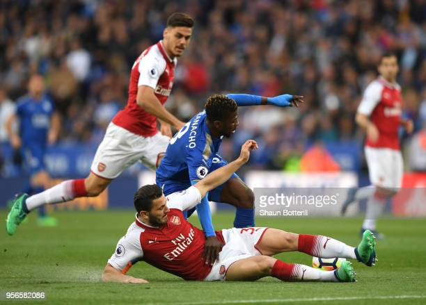 Sead Kolasinac of Arsenal collides with Kelechi Iheanacho of Leicester City and Konstantinos Mavropanos of Arsenal looks on during the Premier League...