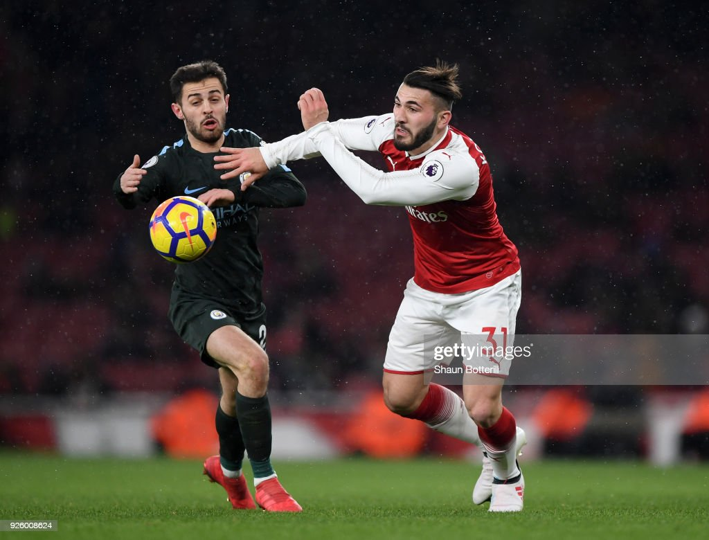 Sead Kolasinac of Arsenal gets to the ball ahead of Bernardo Silva of Manchester City during the Premier League match between Arsenal and Manchester City at Emirates Stadium on March 1, 2018 in London, England.