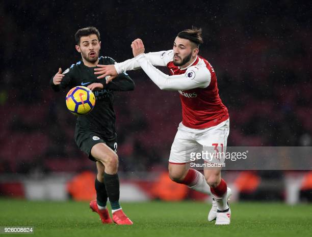 Sead Kolasinac of Arsenal gets to the ball ahead of Bernardo Silva of Manchester City during the Premier League match between Arsenal and Manchester...