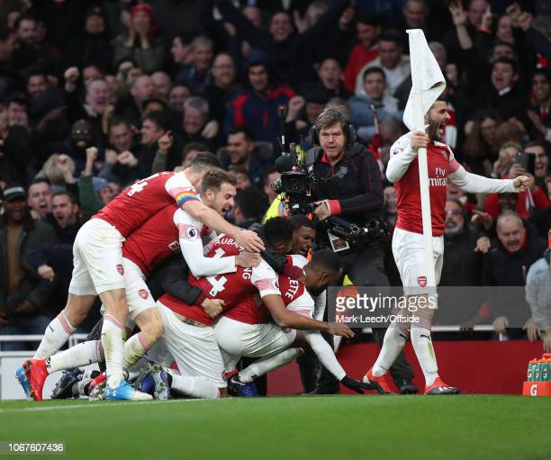 Sead Kolasinac of Arsenal grabs the corner flag as Arsenal celebrate their third goal during the Premier League match between Arsenal FC and...