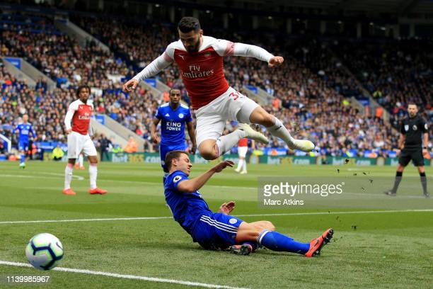 Sead Kolasinac of Arsenal in action with Jonny Evans of Leicester City during the Premier League match between Leicester City and Arsenal FC at The...