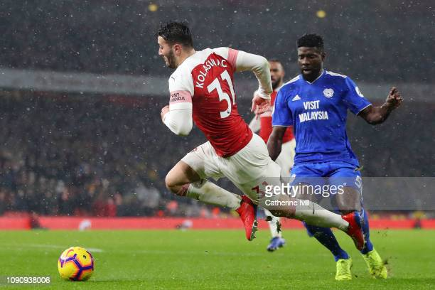 Sead Kolasinac of Arsenal is fouled by Bruno Ecuele Manga of Cardiff City in the penalty area and a penalty is awarded to Arsenal during the Premier...