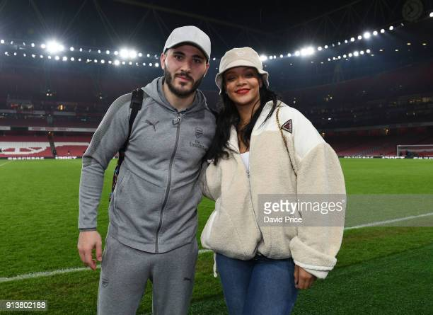 Sead Kolasinac of Arsenal meets pop star Rihanna after the Premier League match between Arsenal and Everton at Emirates Stadium on February 3 2018 in...