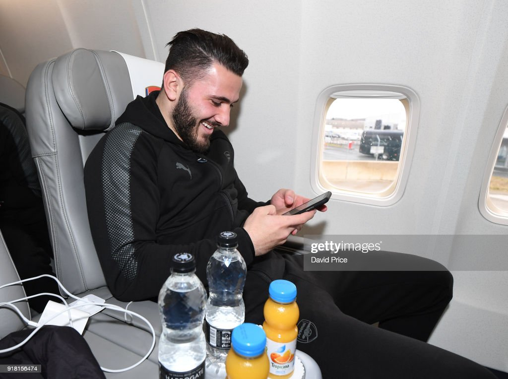 Sead Kolasinac of Arsenal on the plane for the flight to Sweden at Luton Airport on February 14, 2018 in Luton, England.