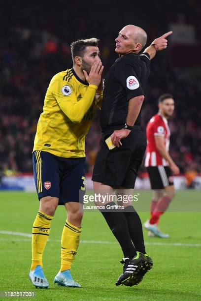 Sead Kolasinac of Arsenal protests to match Referee Mike Dean during the Premier League match between Sheffield United and Arsenal FC at Bramall Lane...