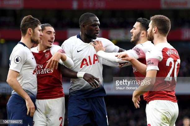 Sead Kolasinac of Arsenal reacts to Moussa Sissoko of Tottenham Hotspur during the Premier League match between Arsenal FC and Tottenham Hotspur at...