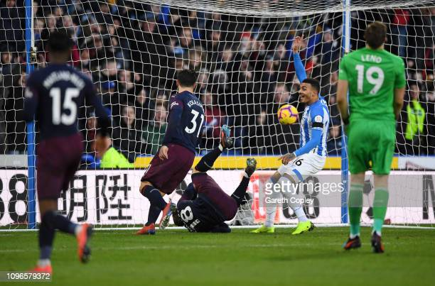 Sead Kolasinac of Arsenal scores an own goal for Huddersfield Town's first goal during the Premier League match between Huddersfield Town and Arsenal...