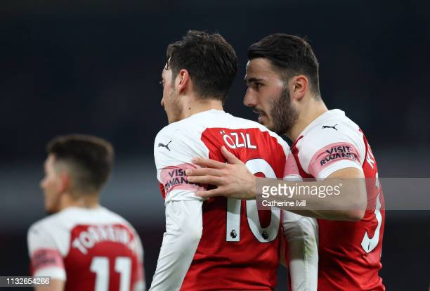 Sead Kolasinac of Arsenal speaks to Mesut Ozil of Arsenal during the Premier League match between Arsenal FC and AFC Bournemouth at Emirates Stadium...