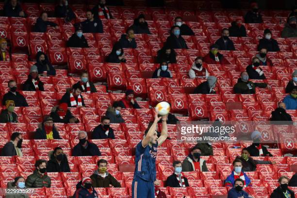Sead Kolasinac of Arsenal takes a throw-in in front of socially distanced fans at The Emirates during the UEFA Europa League Group B stage match...