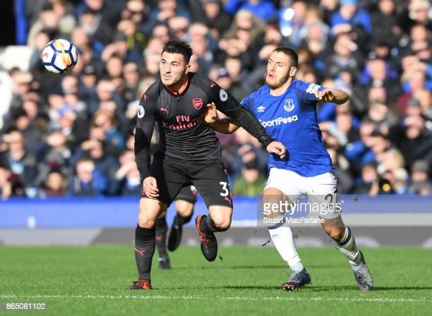 Sead Kolasinac of Arsenal takes on Nikola Vlasic of Everton during the Premier League match between Everton and Arsenal at Goodison Park on October...