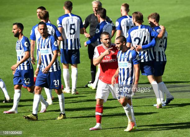 Sead Kolasinac of Arsenal talks with Neal Maupay of Brighton after the Premier League match between Brighton & Hove Albion and Arsenal FC at American...