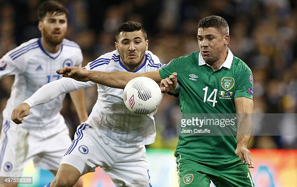 Sead Kolasinac of Bosnia and Herzegovina and Jon Walters of Ireland in action during the UEFA EURO 2016 qualifier playoff second leg match between...