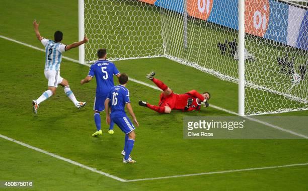 Sead Kolasinac of Bosnia and Herzegovina scores an own goal past goalkeeper Asmir Begovic as Ezequiel Garay of Argentina celebrates during the 2014...