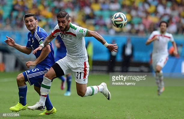 Sead Kolasinac of BosniaHerzegovina and Ashkan Dejagah of Iran vie for the ball during the 2014 FIFA World Cup Group F soccer match between...
