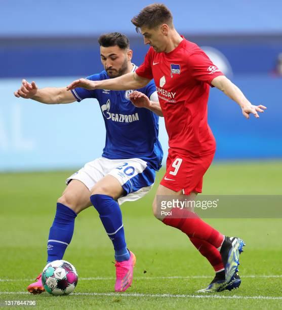Sead Kolasinac of FC Schalke 04 battles for possession with Krzysztof Piatek of Hertha BSC during the Bundesliga match between FC Schalke 04 and...