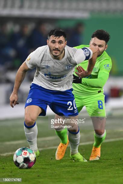 Sead Kolasinac of FC Schalke 04 battles for possession with Renato Steffen of VfL Wolfsburg during the DFB Cup Round of Sixteen match between VfL...