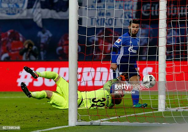 Sead Kolasinac of FC Schalke 04 scores his team's first goal against goalkeeper Peter Gulacsi of RB Leipzig during the Bundesliga match between RB...