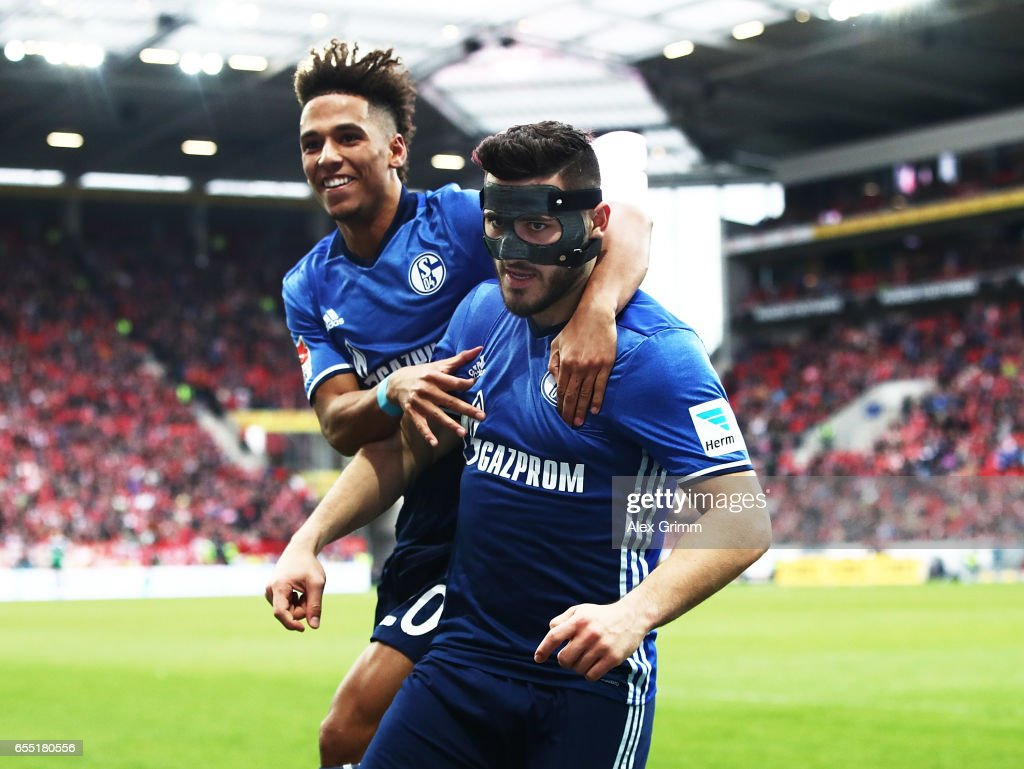 Sead Kolasinac of Schalke 04 is congratulated by Thilo Kehrer of Schalke 04 after scoring a goal during the Bundesliga match between 1. FSV Mainz 05 and FC Schalke 04 at Opel Arena on March 19, 2017 in Mainz, Germany.