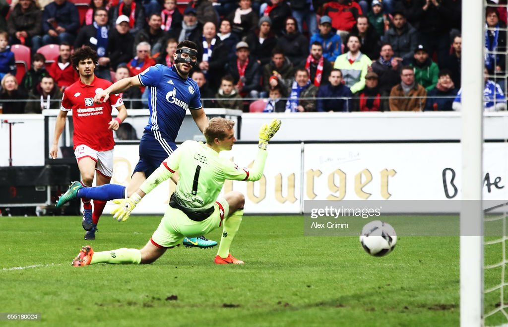 Sead Kolasinac of Schalke 04 scores a goal past Jonas Loessl of FSV Mainz 05 during the Bundesliga match between 1. FSV Mainz 05 and FC Schalke 04 at Opel Arena on March 19, 2017 in Mainz, Germany.