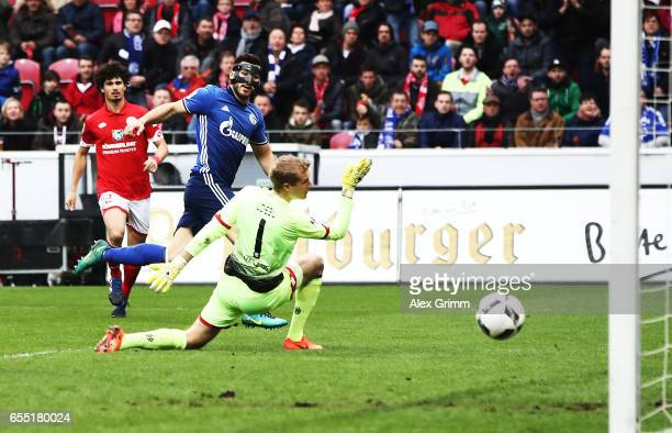 Sead Kolasinac of Schalke 04 scores a goal past Jonas Loessl of FSV Mainz 05 during the Bundesliga match between 1 FSV Mainz 05 and FC Schalke 04 at...