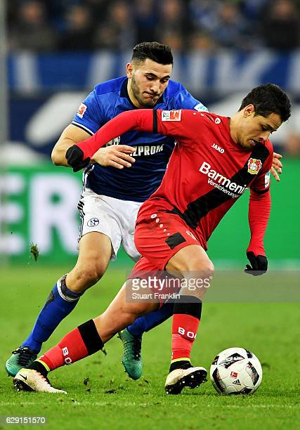 Sead Kolasinac of Schalke battles for the ball with Chicharito of Leverkusen during the Bundesliga match between FC Schalke 04 and Bayer 04...