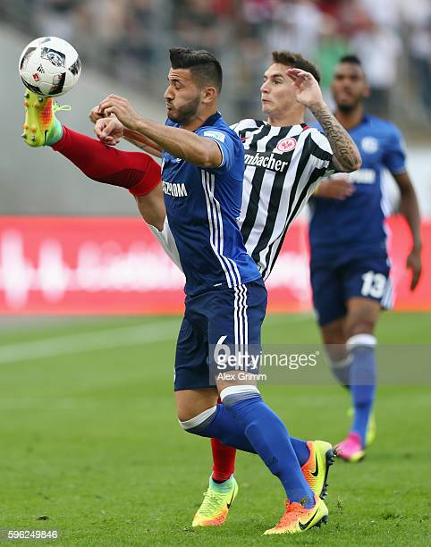 Sead Kolasinac of Schalke is challenged by Guillermo Varela of Frankfurt during the Bundesliga match between Eintracht Frankfurt and FC Schalke 04 at...