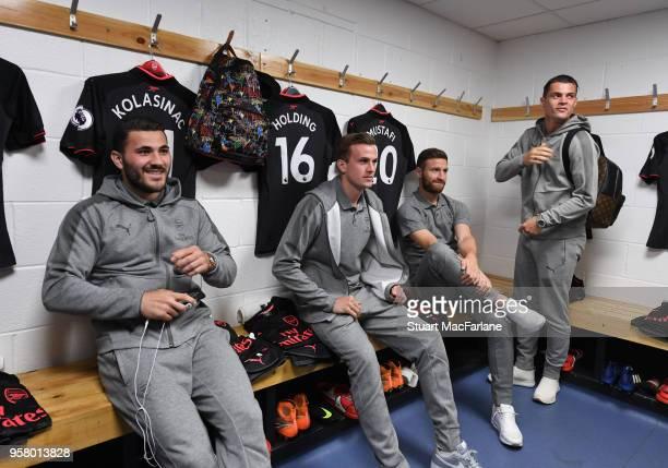 Sead Kolasinac Rob Holding Shkodran Mustafi and Granit Xhaka in the Arsenal changing room before the Premier League match between Huddersfield Town...