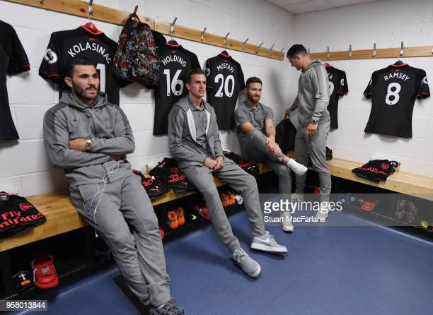 Sead Kolasinac Rob Holding Shkodran Mustafi and Granit Xhaka in the Arsenal changing room before the Premier League match between Huddersfield Town...