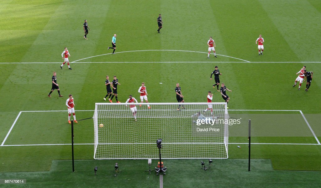 Sead Kolasinac (red shirt far right) scores Arsenal's 1st goal during the Premier League match between Arsenal and Swansea City at Emirates Stadium on October 28, 2017 in London, England.