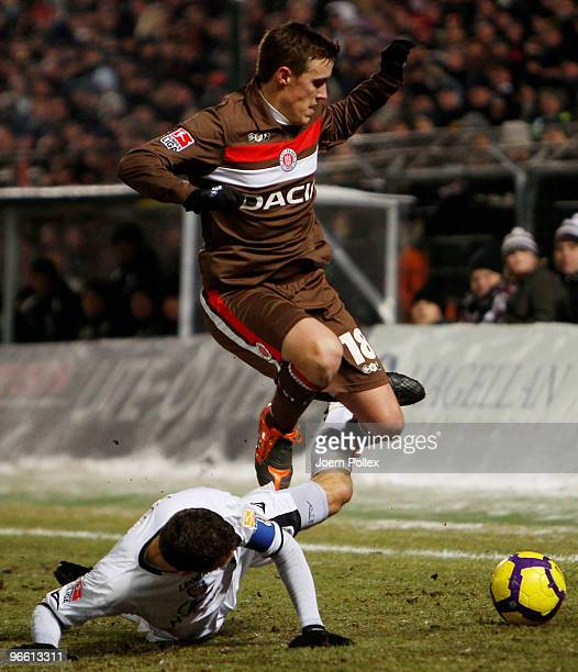 Sead Mehic of Frankfurt and Max Kruse of St Pauli battle for the ball during the Second Bundesliga match between FC St Pauli and FSV Frankfurt at the...